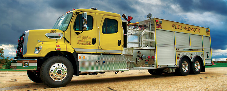 The Big Prairie (MI) Fire Department had Spencer build this top-mount/side-mount pumper with a raised pump panel facing the midline of the vehicle.