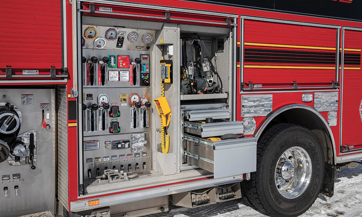 Pierce Manufacturing Inc. built this custom pumper with a side-mount pump panel and operator's equipment storage trays behind a roll-up door. (Photos 9-11 courtesy of Pierce Manufacturing Inc.)