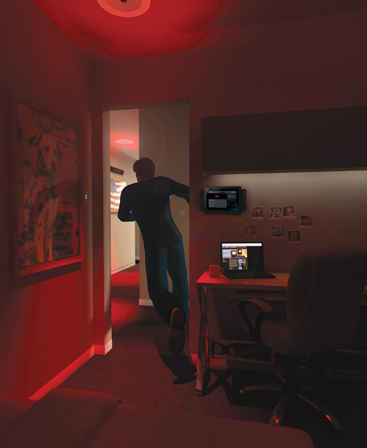A firefighter responds from a dorm room that has USDD red alert lighting as well as a G2 room remote alerting monitor that shows details of the call.