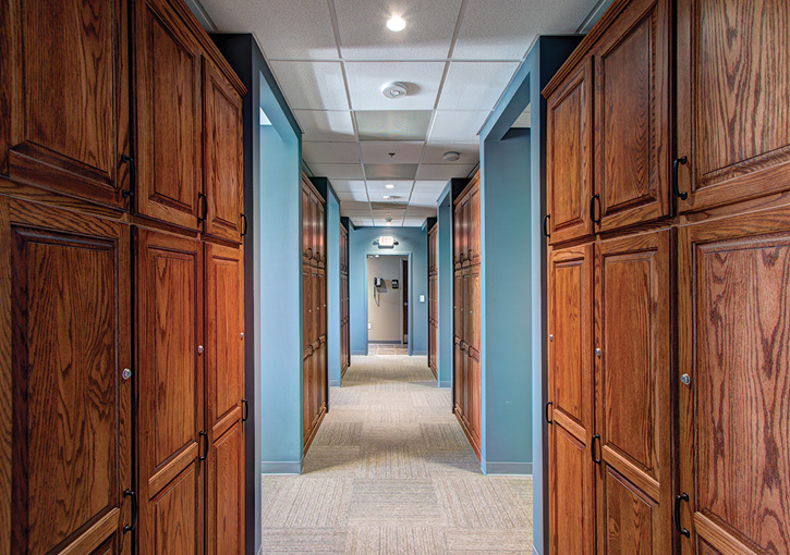 Stewart-Cooper-Newell Architects designs the corridors leading to bunk rooms as quiet areas with muted colors and controllable lighting.