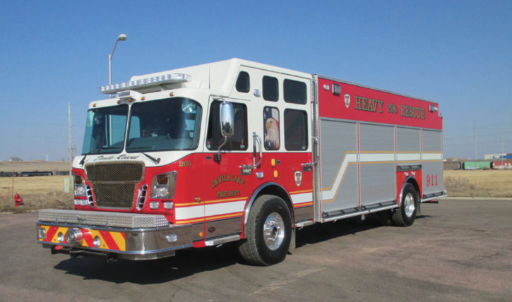 Spartan ER built a wet rescue on a custom walk-around heavy-rescue chassis for the Devil's Lake (ND) Fire Department with a Hale KP2 400-gpm rear-mount pump, a 350-gallon water tank, a 30-gallon foam tank, and swing-out hose reels. (Photo 9 courtesy of Spartan ER.)