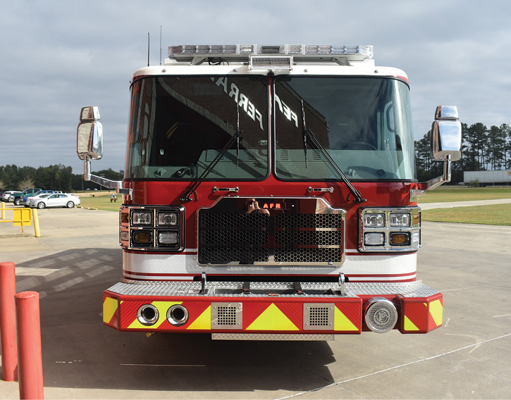 The pumper's 18-inch front bumper extension holds 100 feet of 1¾-inch hose in a black Turtle Tile lined compartment.