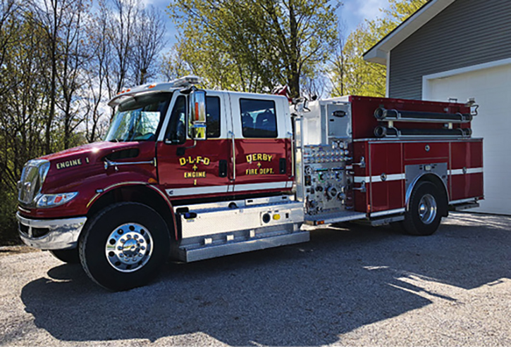 The Derby Line (VT) Fire Department also runs a four-door E-ONE Navistar pumper. Theirs has a side-mount pump panel and hinged doors.
