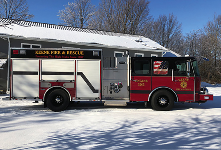 Keene, New York, runs this E-ONE Typhoon custom cab stainless steel rescue-pumper with a 1,250-gpm pump and 1,000-gallon tank. It has a side-mount pump panel, shutter doors, and a flat cab roof.