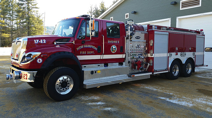 This E-ONE four-door Navistar 475-hp pumper-tanker with 2,500 gallons of water was delivered to New Hampton, New Hampshire. There's a front suction inlet extending through the front bumper, collapsible hose on the rewind reels above the pump house, and a combination of shutter and hinged doors on the body.