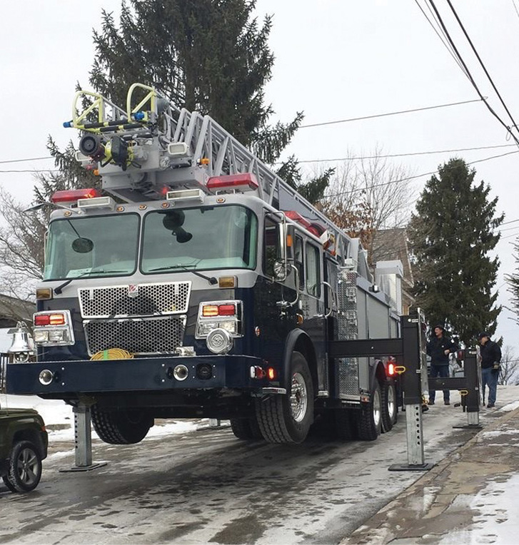 The Smeal 105-foot aerial ladder has four H-style outriggers that spread to 16 feet, two behind the cab and two behind the rear axle.