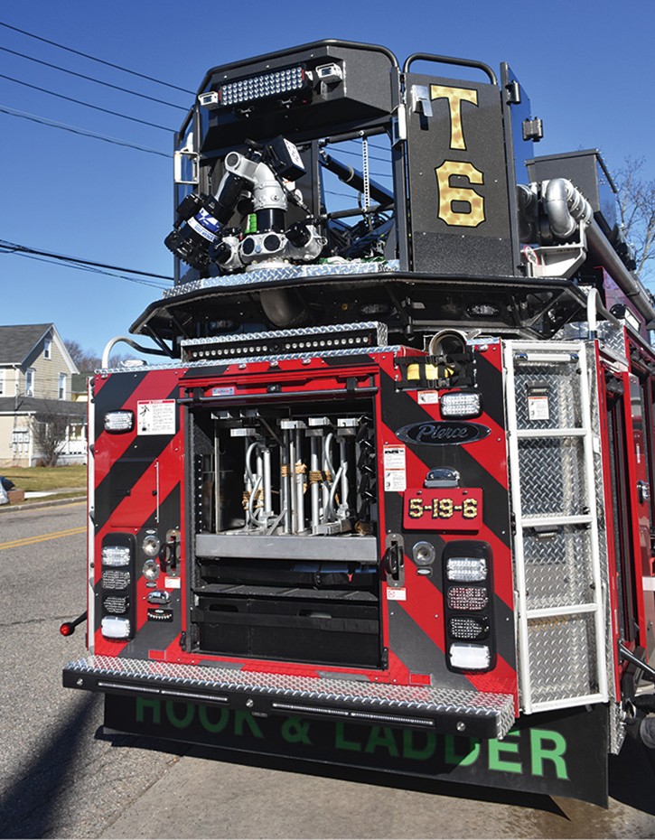 Rear ladder storage and a single TFT Monsoon deck gun attached to bucket.