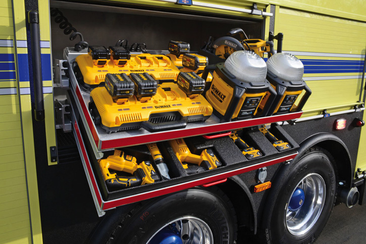 A compartment dedicated to DeWalt battery-powered tools with extra batteries on charge.