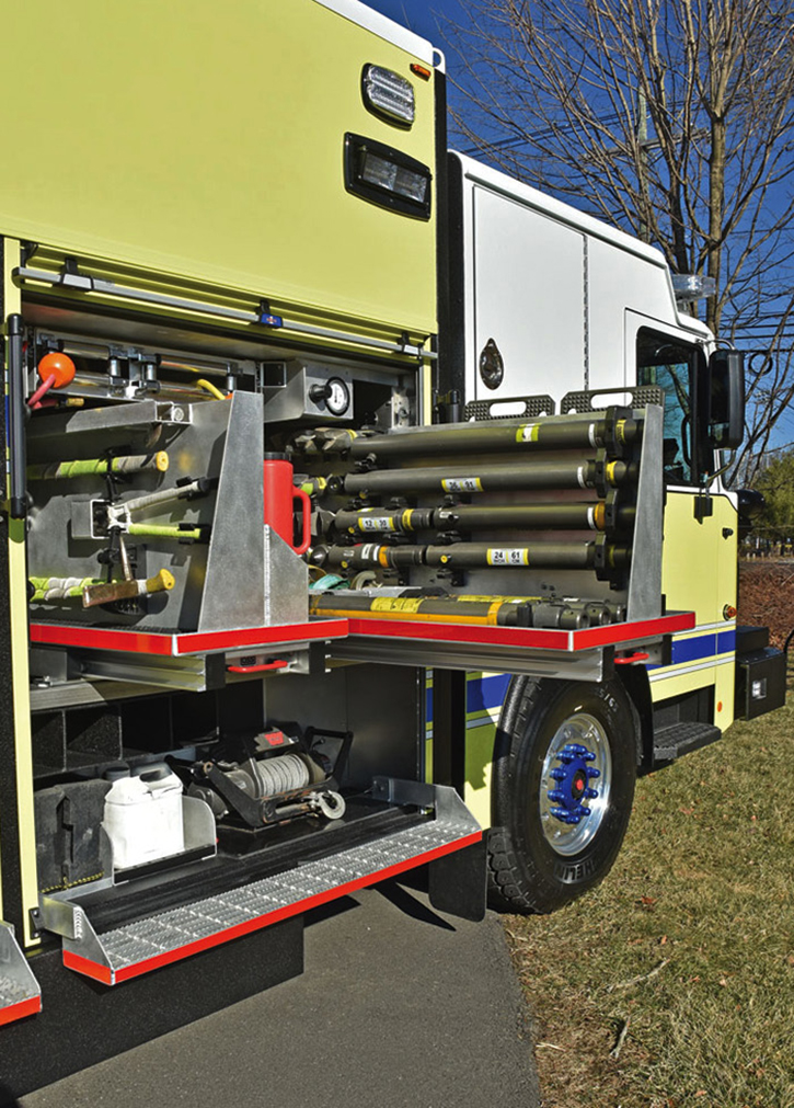 Paratech struts, a portable winch, and air and electric lines.