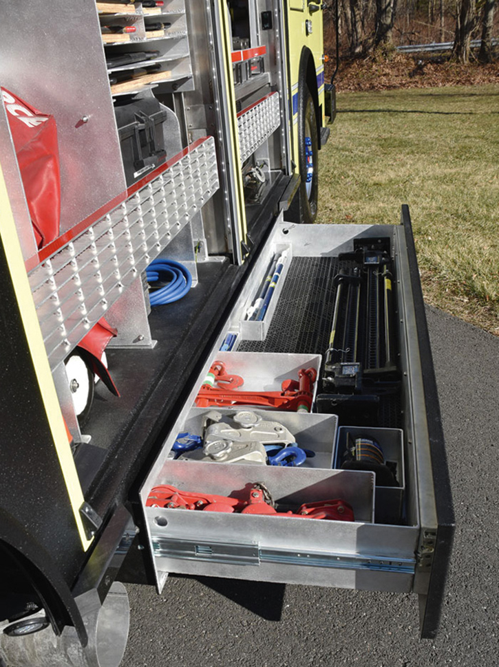A roll-out under-body compartment with rigging equipment.