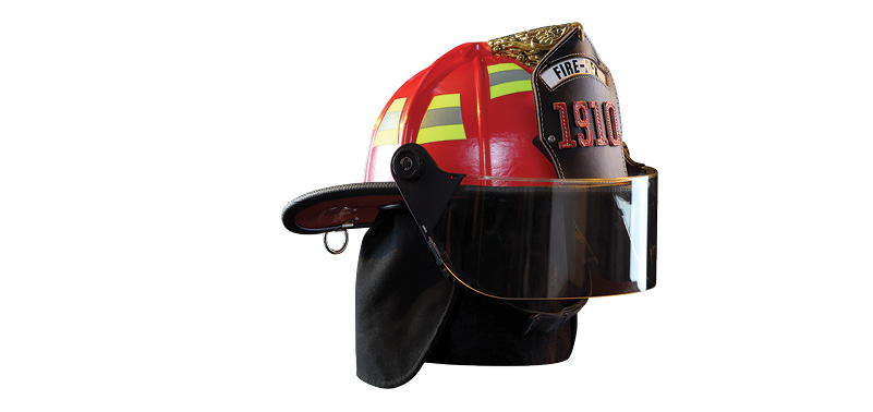 Fire-Dex makes both traditional (shown) and modern design fire helmets with fiberglass shells, thermal impact caps, and three-piece headband and ratchet assembly.