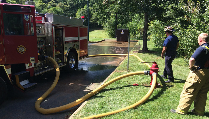 In an effort to position for the driver's side main intake, this apparatus was forced to stay farther off the curb. This resulted in the apparatus having a larger profile in the roadway. It also increased the probability of kinks. Since the hydrant outlet and pump intake are fixed objects, the supply line will be the object that moves and thus kinks.