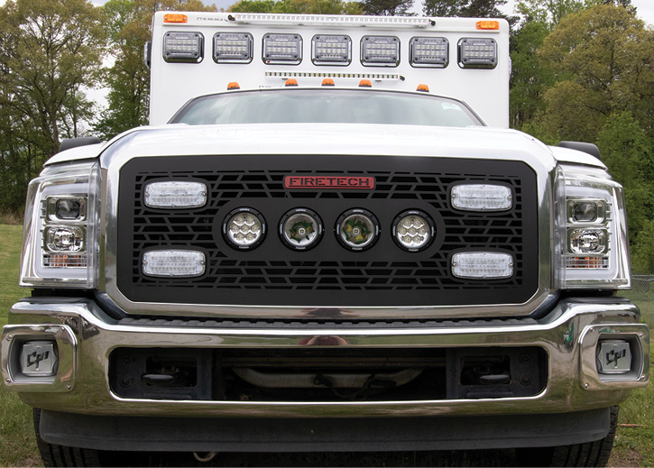 This ambulance has HiViz's Guardian LED surface-mount scene lights at the top of the patient module and a series of FireTech LED grille lights.
