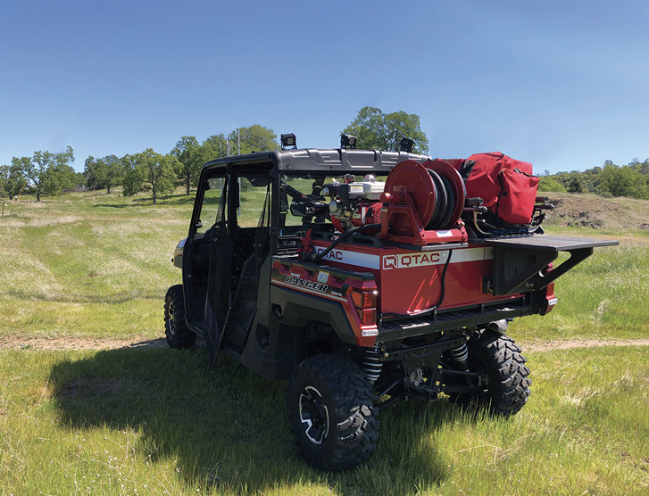 The Chico (CA) Fire Department uses a QTAC 85EMS-C fire/rescue skid that has a pump, hose reel, and convertible rescue litter platform on its Polaris Ranger UTV.