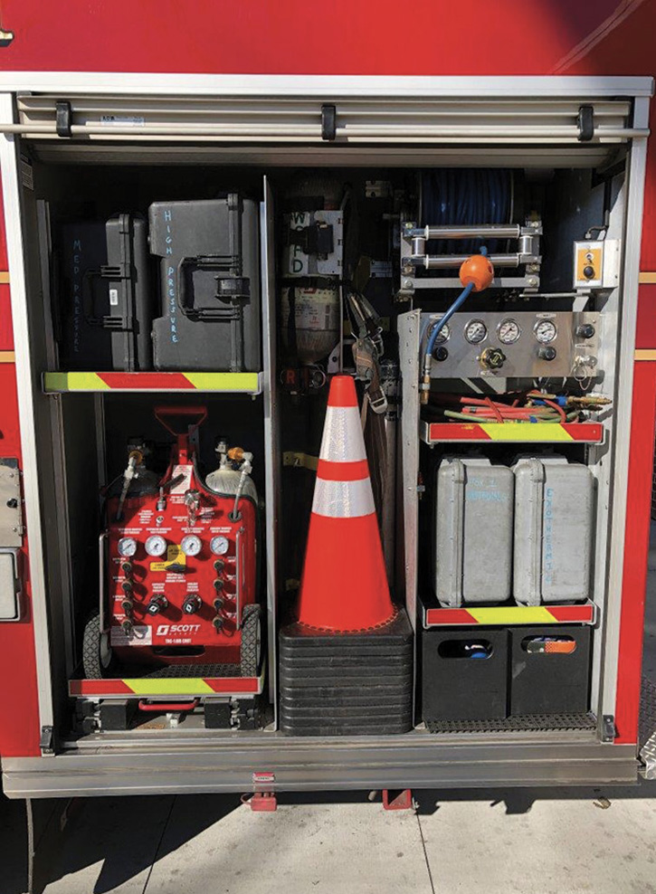 Vertical dividers in a compartment allow flexibility by enabling adjustable shelving to be provided on each side at different heights. Finding storage for single-piece traffic cones favored by many departments can be difficult. Cones are probably one of the few pieces of equipment used every time the rig stops on the road. They should be easy to access.