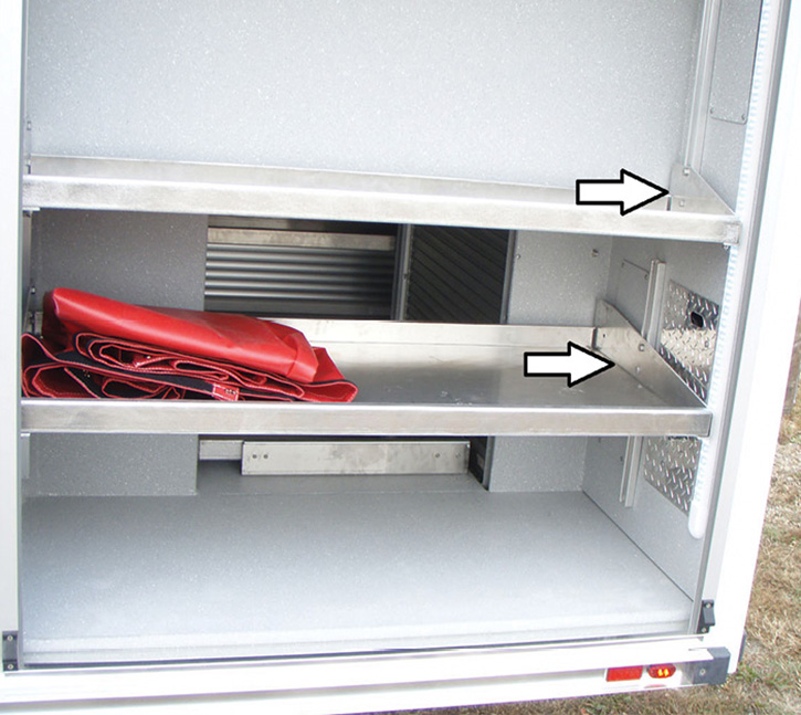 The arrows point to another method of forming side lips on shelves to provide additional support and a dual mounting point to attach the shelf to the unistrut. Adjustable shelving inside equipment compartments allows access to wiring and light assemblies.
