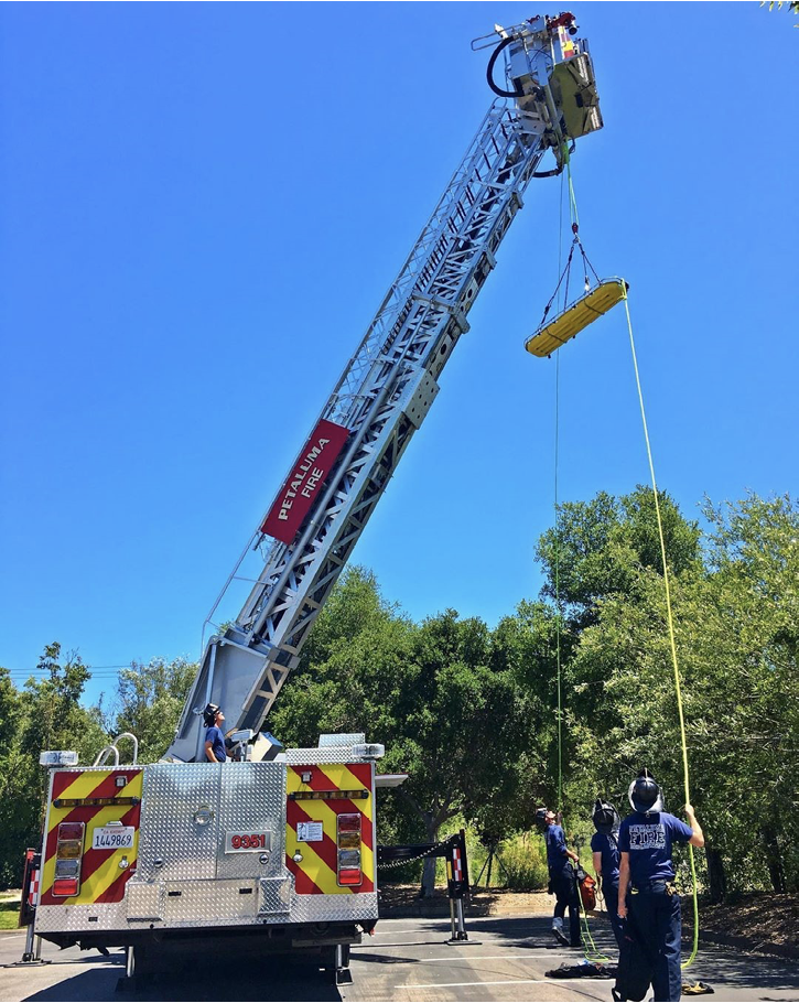 Petaluma (CA) Fire Department members train on this Sutphen aerial ladder platform using the rig's rappelling and rope rescue anchors and fixtures.