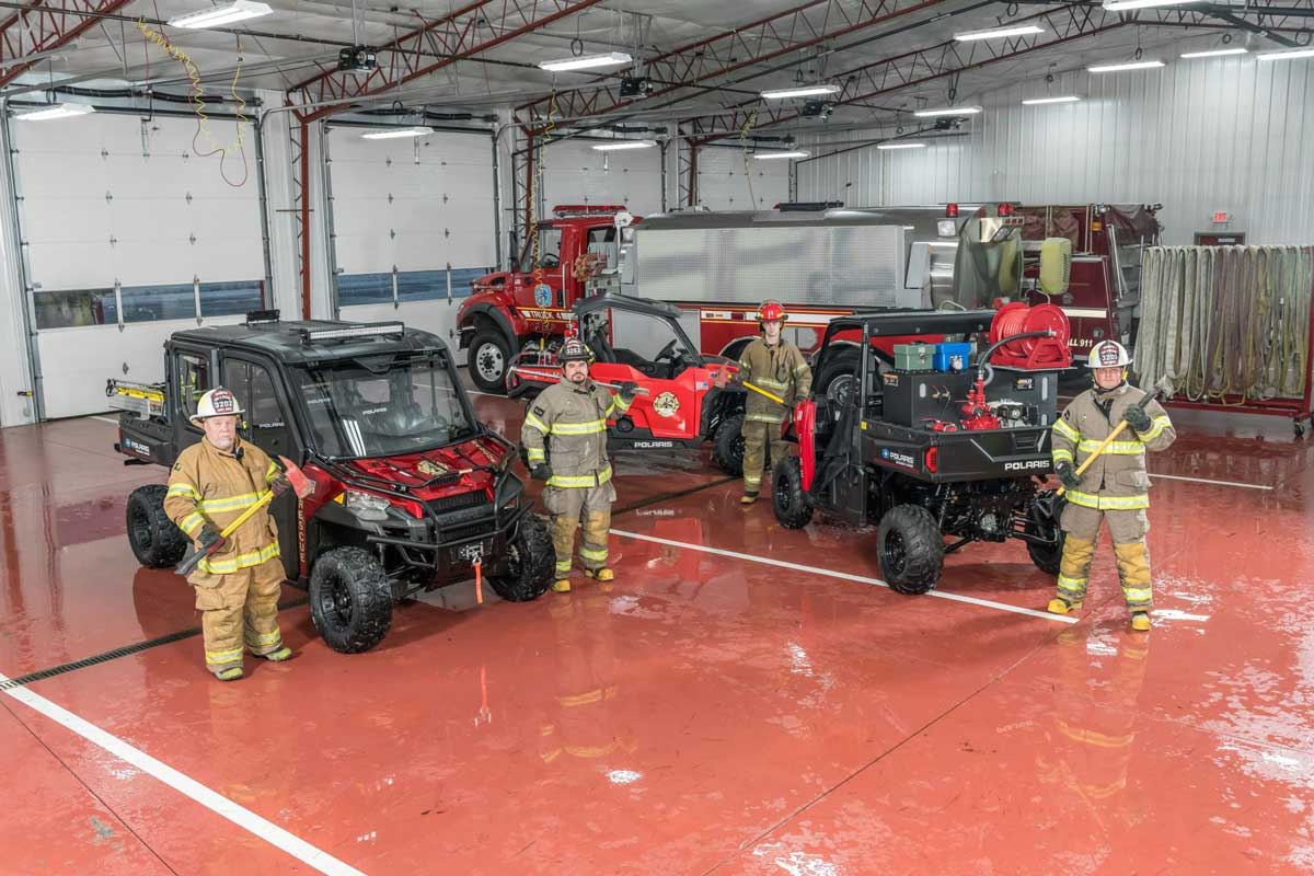 Firefighters with Polaris vehicles