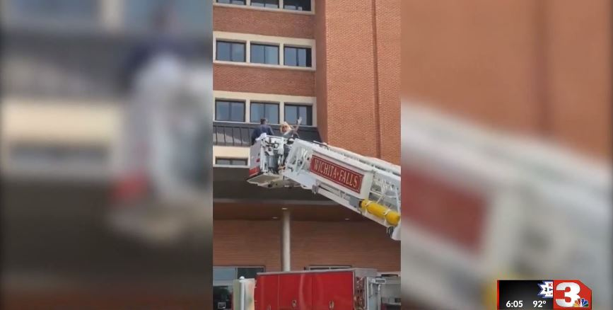 Wichita Falls (TX) Firefighters Use Ladder Truck to Help Wife See Hospitalized Firefighter Husband